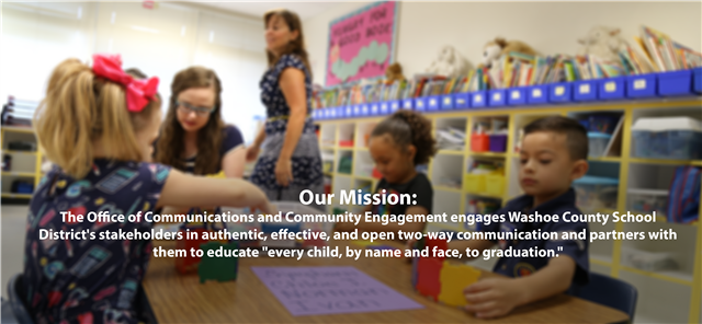"Blurry photo of kindergarteners coloring with the text that read :""Our Mission: The Office of Communications and Community """